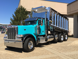 A highly polished dump body on a coal-hauling chassis greets visitors to the main entrance to...