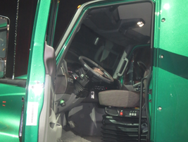 Thinner door panels add some elbow room for the driver. Door's top is canted slightly inward to...
