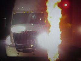 Heralded by fire and smoke, LT625 drives on stage at the launch in Las Vegas.The LT series will...