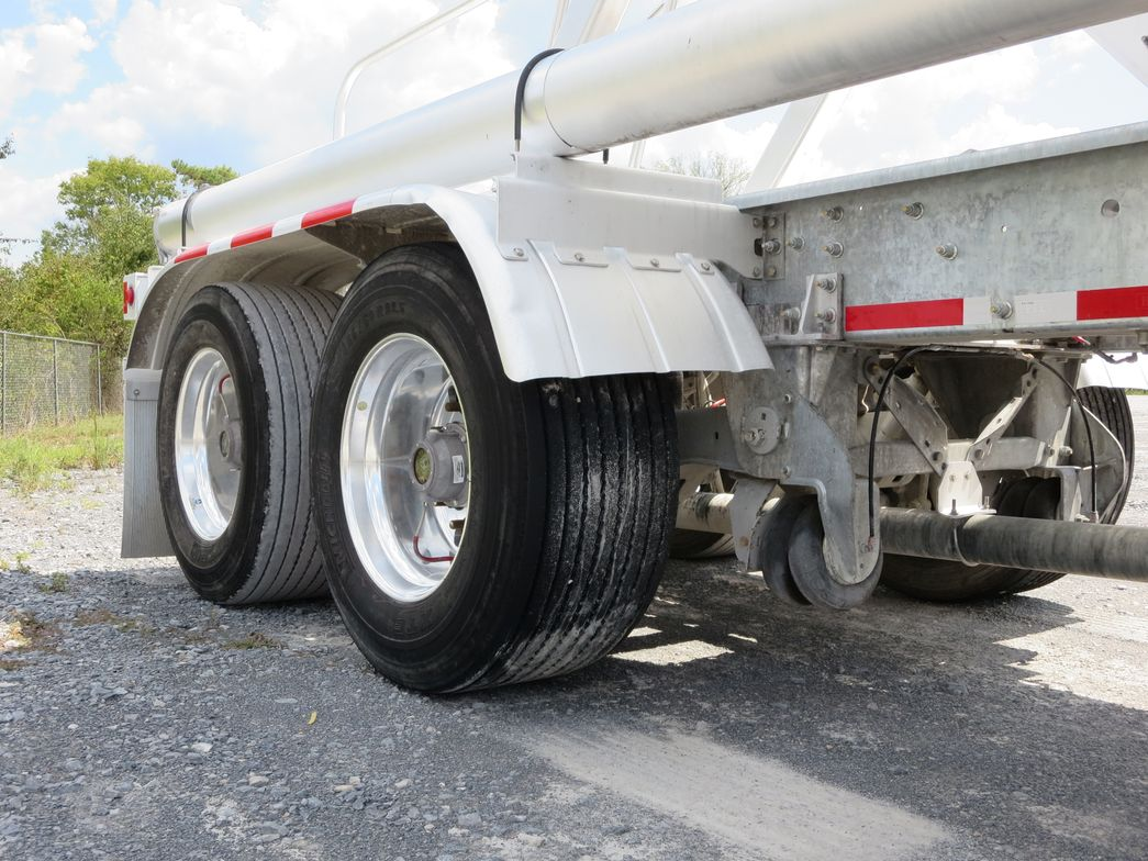 Wide base single tires, like these on a J&M trailer, are a common spec for weight-sensitive...