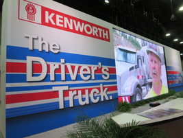"""Kenworth's booth targeted drivers, highlighting its T680 in patriotic colors with a """"Made in..."""