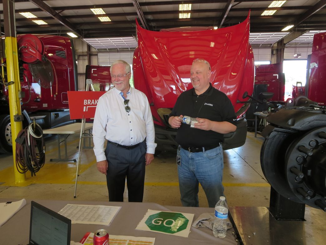 U.S. Xpress Chairman and co-founder Max Fuller, left, for whom the competition is named, chats...