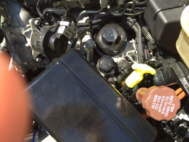 Cartridge-style fuel and oil filters are mounted above the rail for easy access.