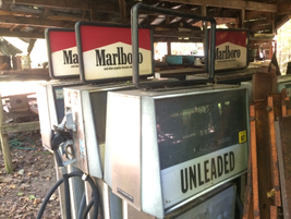 Old gas pumps with cigarette ads on top. Photo: Jack Roberts