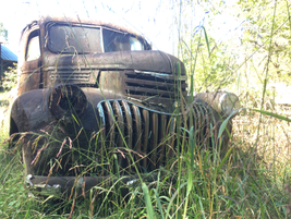 A massive-grilled old Chevy sits alone in the grass. Photo: Jack Roberts