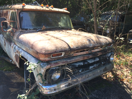 A Chevy sedan delivery wagon rusts away. Photo: Jack Roberts