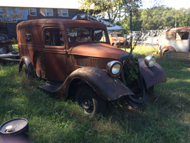 A '30s-vintage Ford sedan delivery van waits near the parking lot. Photo: Jack Roberts