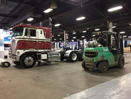Crates, forklifts, rolled-up rugs ... all the signs of a truck show in the setup stages. Photo:...