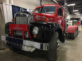 Antique trucks like this Mack are tucked away between booths in the West Wing and Hall. Photo:...