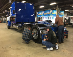 Putting a last-minute polish on a truck on display. Photo: Deborah Lockridge