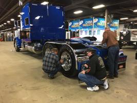 Putting a last-minute polish on a truck on display. Photo: Deborah Lockridge