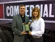 Senior Editor Chris Wolski presents the Medium-Duty Truck of the Year award toBecky Blanchard,...