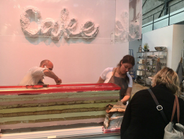 Let them bake cake: Touching up a mega dessert crafted during the event as a teamwork exercise...