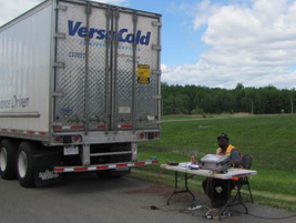Adime Bonsi, a PIT Group researcher, monitors cold- air circulation to develop better trailers...