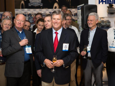 Bob Phillips (center), chairman of Phillips Industries, celebrating the company's 90th...