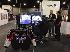 Enjoying a race simulator at the Mobil booth.Photo: Deborah Lockridge