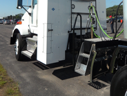 "This tall cabinet behind the Kenworth T800's cab houses four ""bottles"" that carry CNG for the..."