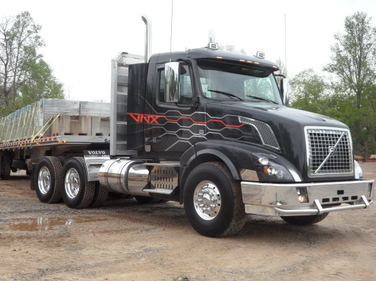 As driven, the tractor pulled a loaded flatbed and the rig scaled at a modest 77,780 pounds.