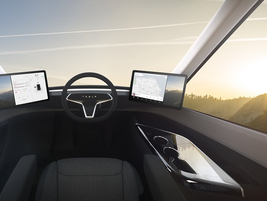 The driver's controls are at once futuristic and minimalistic. Photo: Tesla