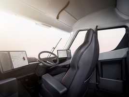 The cab features a center-mounted driver's seat, which Musk said gives superior visibility to...