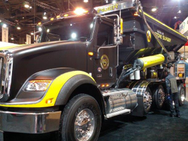 Stone Slinger body sits on a five-axle International HX. Matte-finish paint is Linex Ultra,...