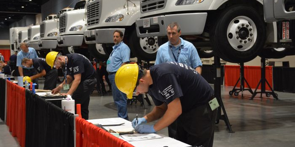 Techs begin an exercise involving truck chassis.