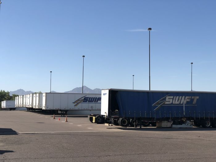 Swift's campus is a vast complex with hundreds of vehicles and trailers as well as the corporate...