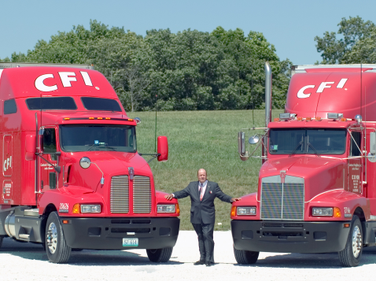 The year before its acquisition by Con-way, CFI chairman and CEO Glenn Brown posed with the...