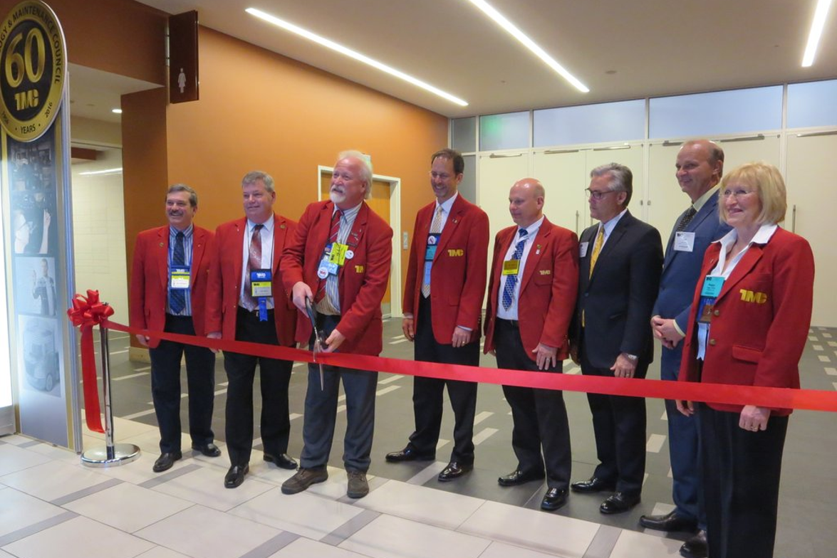Outgoing TMC Chairman Kevin Tomlinson cuts the ceremonial ribbon opening the exhibit hall....