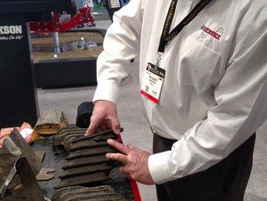 Tony Kockritz, Hendrickson's western service manager, set up a table of worn suspension parts to...