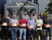 Happy winners pose at U.S. Xpress headquarters. All competing techs got a tour of HQ and got to...