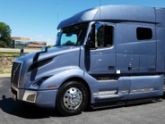 The VNL 740 with a mid-roof sleeper. This is configured for flatbed or tanks that pull lower...