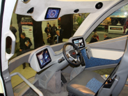 The Walmart WAVE concept truck's interior features a single driver seat in the center of the...