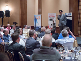 Motivational business speaker Tim Richardson challenges attendees to encourage people at their...