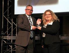 Bill Bliem accepts his HDT Truck Fleet Innovator award from Editor in Chief Deborah Lockridge at...