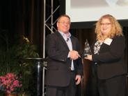 David Hoover accepts his HDT Truck Fleet Innovator award from Editor in Chief Deborah Lockridge...