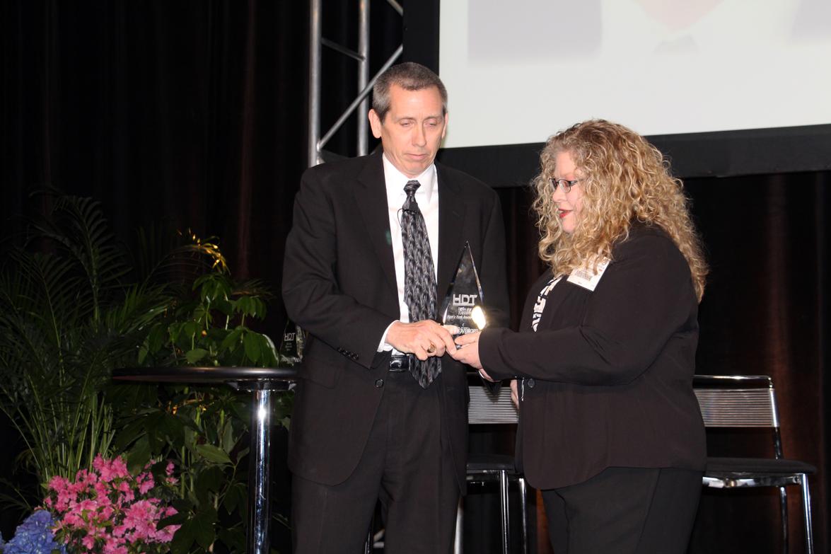 Shelby Green accepts his HDT Truck Fleet Innovator award from Editor in Chief Deborah Lockridge...