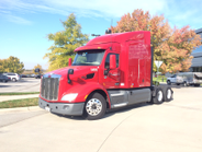 A fuel-economy-spec'd Peterbilt Model 579 away US Xpress headquarters.