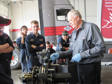 Martin starts the training session by reviewing the various parts of the braking system.