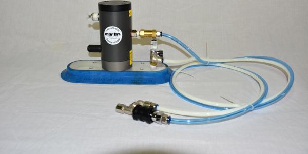 Vacuum-mounted Trailer Vibrator Speeds Unloading