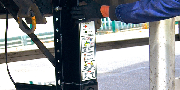 Driver uses two push buttons to pneumatically raise or lower a PTS50's legs while the trailer's...