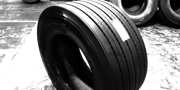 A truck tire just retreaded with Continental's HTL1 ContiTread flat precure tread sits freshly...