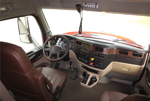 Dark-wood trim is applied to the instrument and door panels. Model can be ordered as a daycab or with one of two sleeper-box lengths.