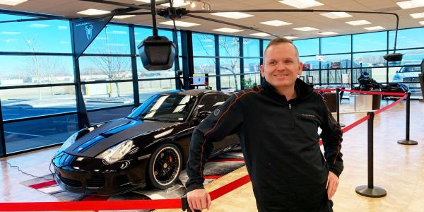 Black Widow founder and CEO Jason Hauk with his multi-armed digital camera system that can...