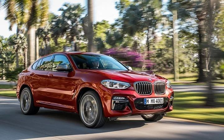 NADA analysts predict the increasing fuel efficiency of light-duty pickups and CUVs such as the BMW X4 will continue to push more consumers away from car segments. - Photo courtesy of BMW Group.