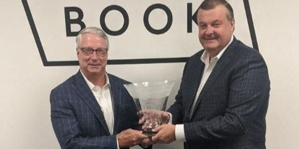 Black Book President Tom Cross (right) presents Tim West with the Bobit Industry Icon Award.