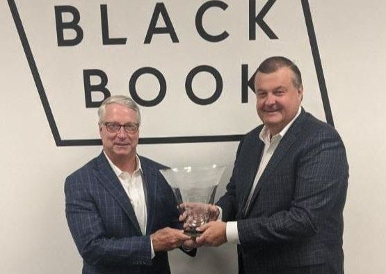 Black Book President Tom Cross (right) presents Tim West with the Bobit Industry Icon Award. - Photo: Black Book
