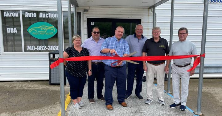 Chad Bailey cuts the ribbon June 3 at the first official sale following Akron Auto Auction's acquisition of Value Auto Auction in Crooksville, Ohio. He was joined by auction partners Tricia Short, Joel Hamsher, and Jeff Bailey as well as VAA founders Bob and Chris Fahey who will stay on as consultants. - Photo: Akron Auto Auction
