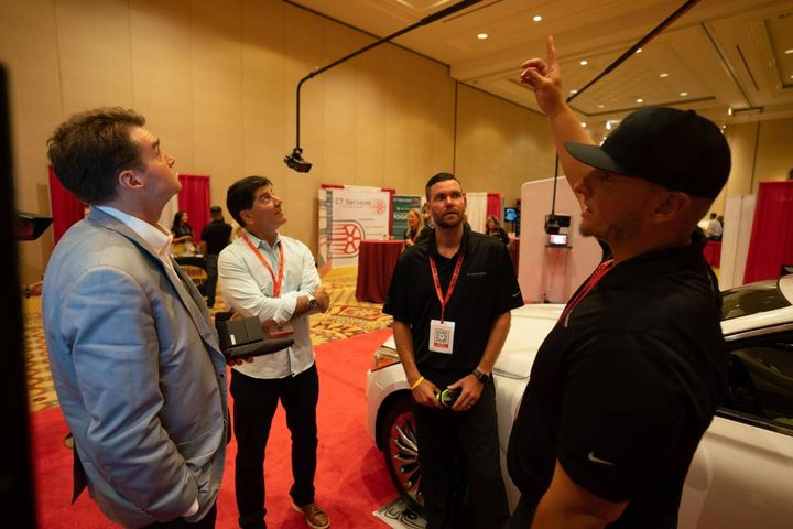 Attendees check out a demo of the Black Widown Imaging system on the exhibit floor during the opening reception on June 16. - Photo: bobit