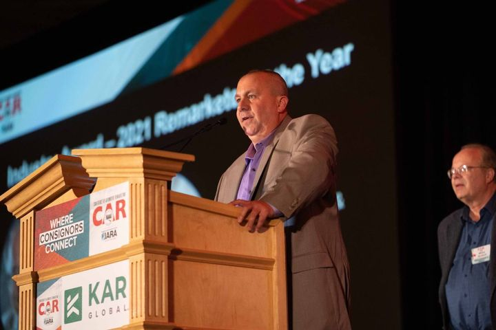Chad Bailey of Akron Auto Auction and Value Auto Auction accepts the 2021 Vehicle Remarketer of the Year Award on June 17, 2021 during the Conference of Automotive Remarketing in Las Vegas. - photo: Bobit